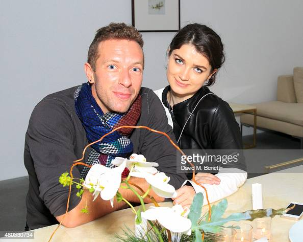 Chris Martin and Eve Hewson attend the Edun Pre Fall Dinner at Alison Jacques Gallery on December 11 2014 in London England