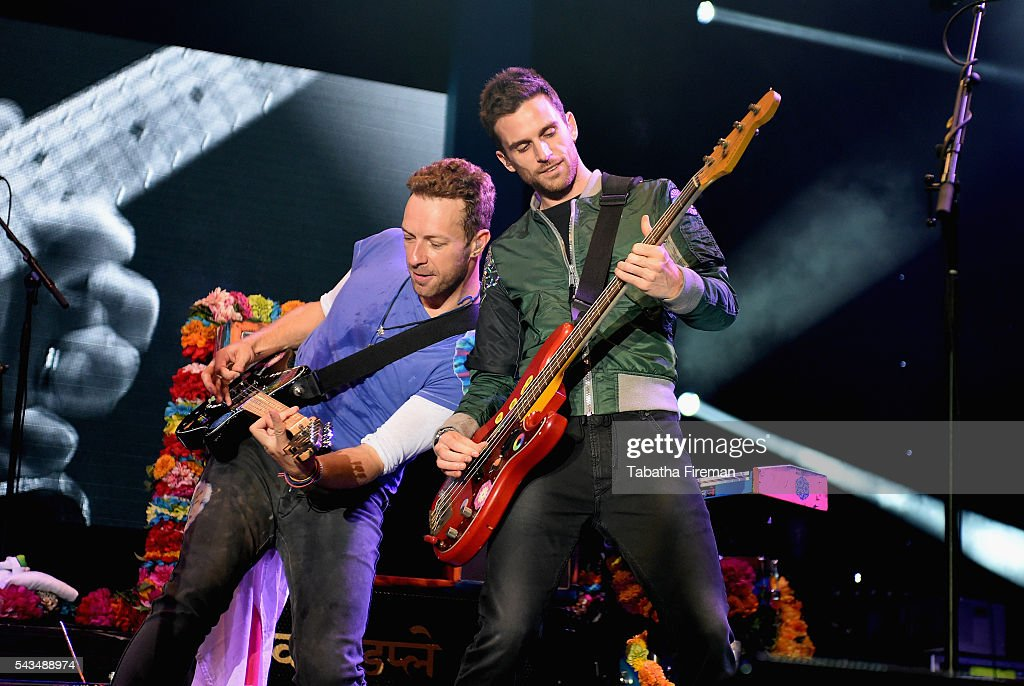<a gi-track='captionPersonalityLinkClicked' href=/galleries/search?phrase=Chris+Martin+-+Musician&family=editorial&specificpeople=4468181 ng-click='$event.stopPropagation()'>Chris Martin</a> and <a gi-track='captionPersonalityLinkClicked' href=/galleries/search?phrase=Guy+Berryman&family=editorial&specificpeople=240270 ng-click='$event.stopPropagation()'>Guy Berryman</a> from Coldplay perform on stage during the Sentebale Concert at Kensington Palace on June 28, 2016 in London, England. Sentebale was founded by Prince Harry and Prince Seeiso of Lesotho over ten years ago. It helps the vulnerable and HIV positive children of Lesotho and Botswana.