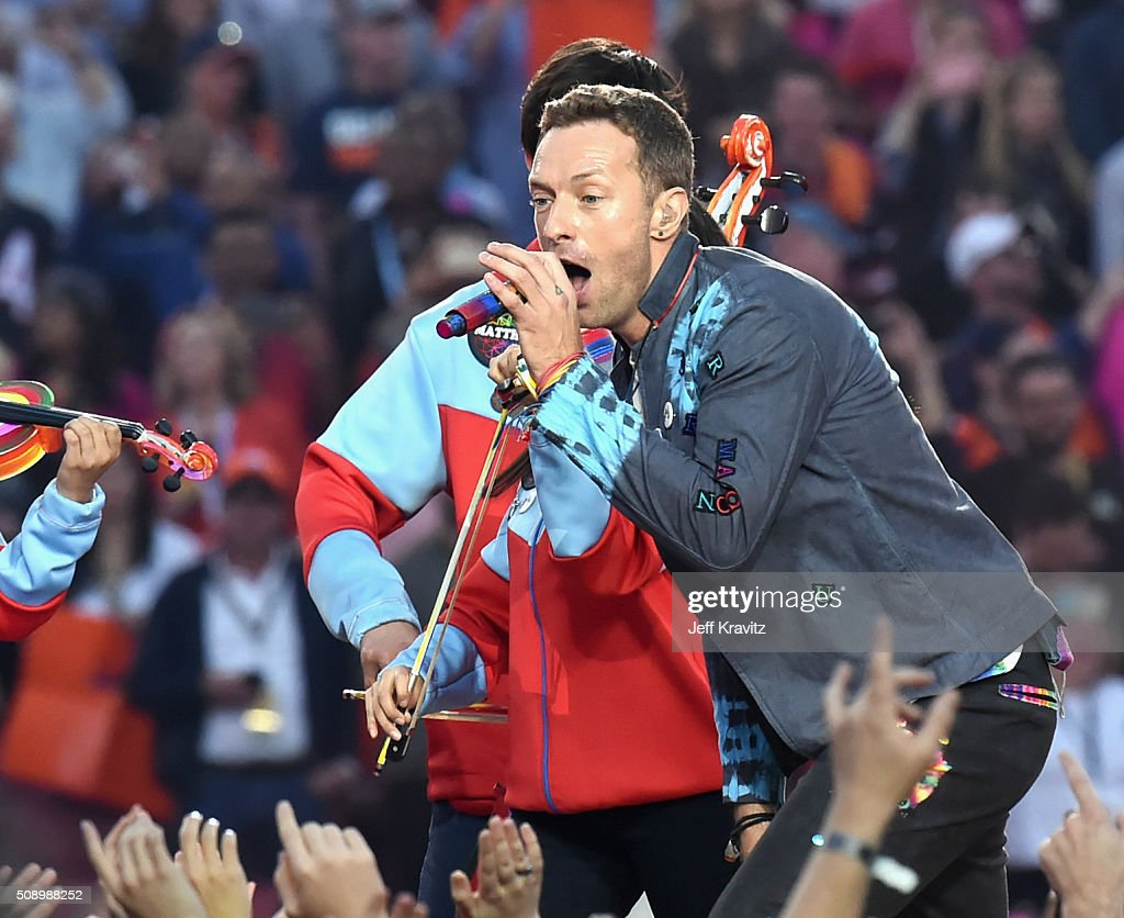 Chris Martin and Guy Berryman of Coldplay perform onstage during the Pepsi Super Bowl 50 Halftime Show at Levi's Stadium on February 7, 2016 in Santa Clara, California.