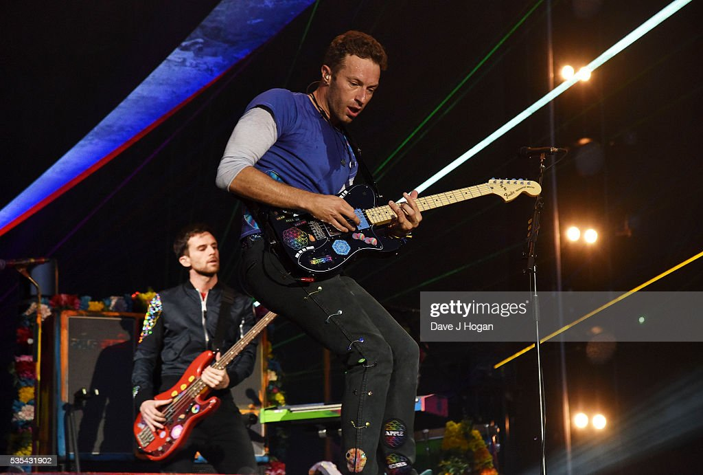 <a gi-track='captionPersonalityLinkClicked' href=/galleries/search?phrase=Chris+Martin+-+Musician&family=editorial&specificpeople=4468181 ng-click='$event.stopPropagation()'>Chris Martin</a> and <a gi-track='captionPersonalityLinkClicked' href=/galleries/search?phrase=Guy+Berryman&family=editorial&specificpeople=240270 ng-click='$event.stopPropagation()'>Guy Berryman</a> of Coldplay performs during day 2 of BBC Radio 1's Big Weekend at Powderham Castle on May 29, 2016 in Exeter, England.