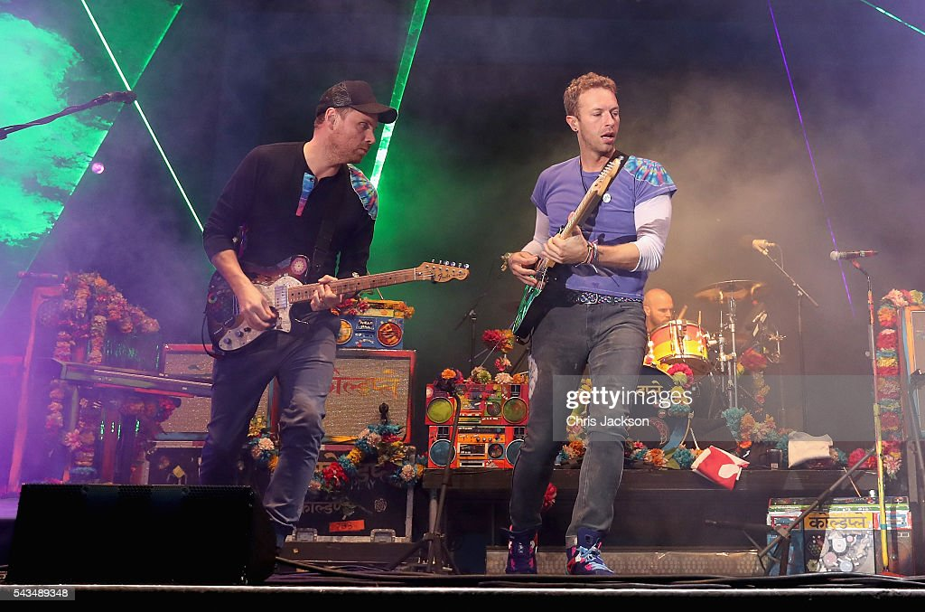 <a gi-track='captionPersonalityLinkClicked' href=/galleries/search?phrase=Chris+Martin+-+Musician&family=editorial&specificpeople=4468181 ng-click='$event.stopPropagation()'>Chris Martin</a> and <a gi-track='captionPersonalityLinkClicked' href=/galleries/search?phrase=Jonny+Buckland&family=editorial&specificpeople=235773 ng-click='$event.stopPropagation()'>Jonny Buckland</a> from Coldplay perform on stage during the Sentebale Concert at Kensington Palace on June 28, 2016 in London, England. Sentebale was founded by Prince Harry and Prince Seeiso of Lesotho over ten years ago. It helps the vulnerable and HIV positive children of Lesotho and Botswana.