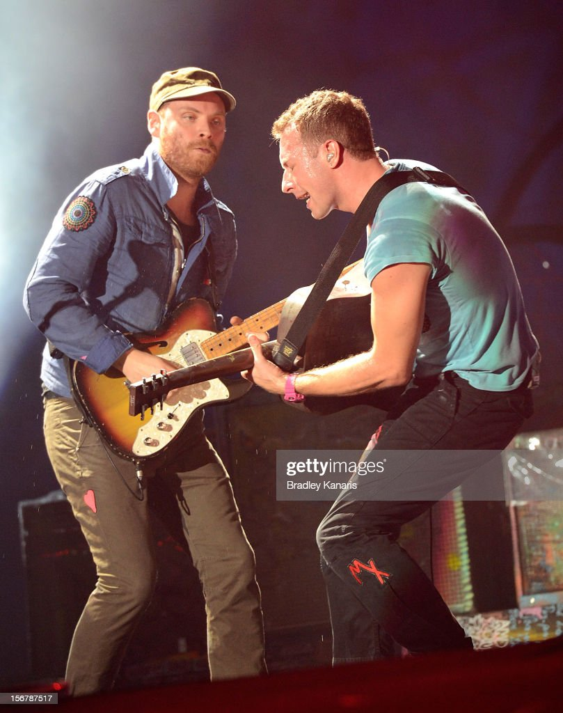 Chris Martin and Jonny Buckland of Coldplay perform live for fans at Suncorp Stadium on November 21, 2012 in Brisbane, Australia.