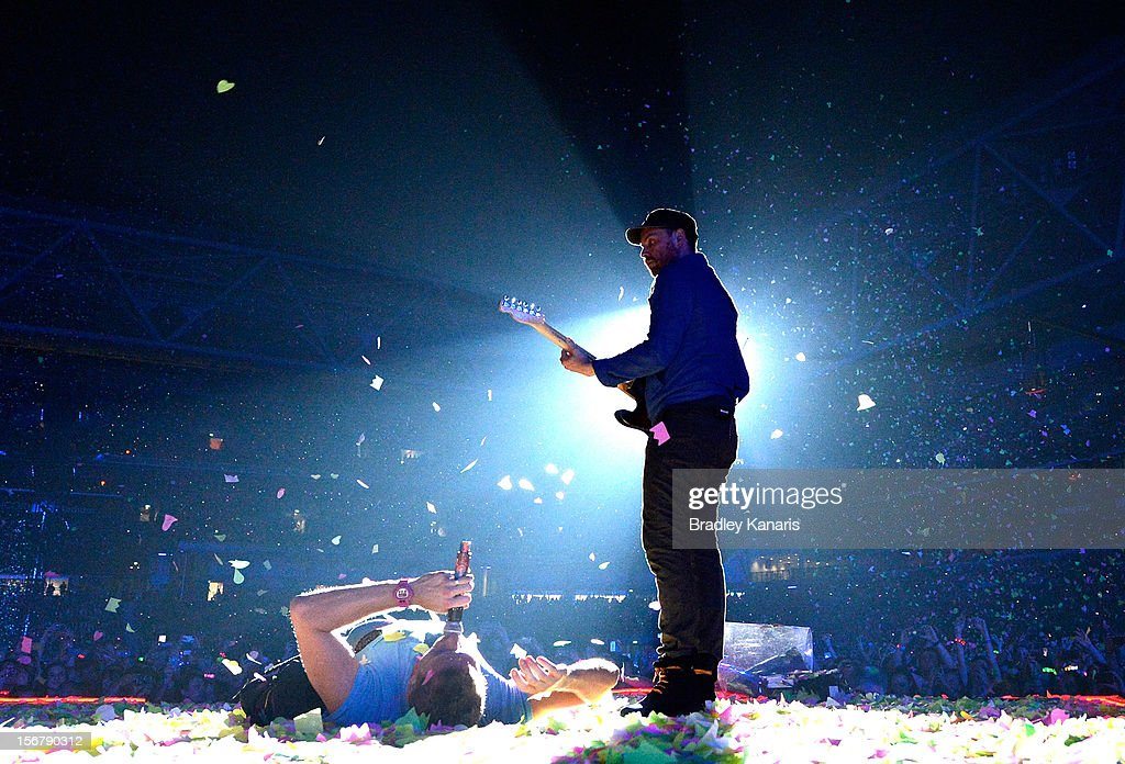 Chris Martin and <a gi-track='captionPersonalityLinkClicked' href=/galleries/search?phrase=Jonny+Buckland&family=editorial&specificpeople=235773 ng-click='$event.stopPropagation()'>Jonny Buckland</a> of <a gi-track='captionPersonalityLinkClicked' href=/galleries/search?phrase=Coldplay&family=editorial&specificpeople=228782 ng-click='$event.stopPropagation()'>Coldplay</a> perform live for fans at Suncorp Stadium on November 21, 2012 in Brisbane, Australia.