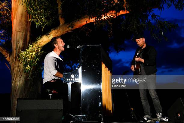 Chris Martin and Jonny Buckland of Coldplay perform on stage at the Communities In Schools Of Los Angeles Annual Gala on May 18 2015 in Pacific...