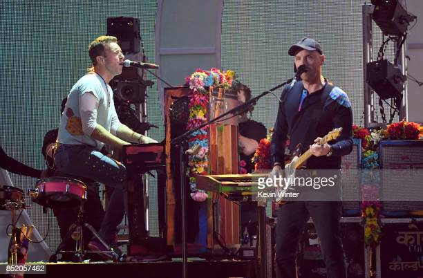 Chris Martin and Jonny Buckland of Coldplay perform onstage during the 2017 iHeartRadio Music Festival at TMobile Arena on September 22 2017 in Las...