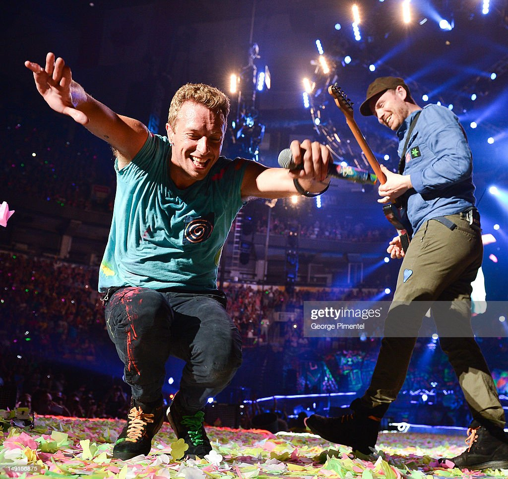 Chris Martin and Jonny Buckland of Coldplay performs at Air Canada Centre on July 23, 2012 in Toronto, Canada.