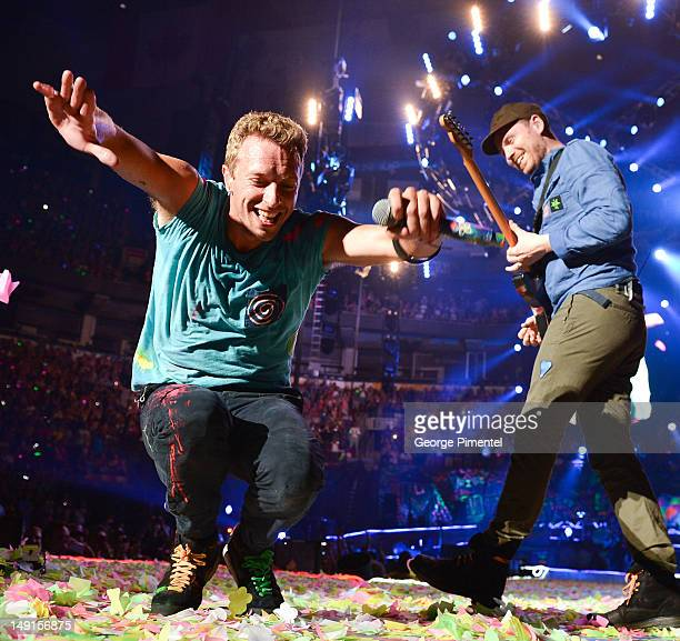 Chris Martin and Jonny Buckland of Coldplay performs at Air Canada Centre on July 23 2012 in Toronto Canada