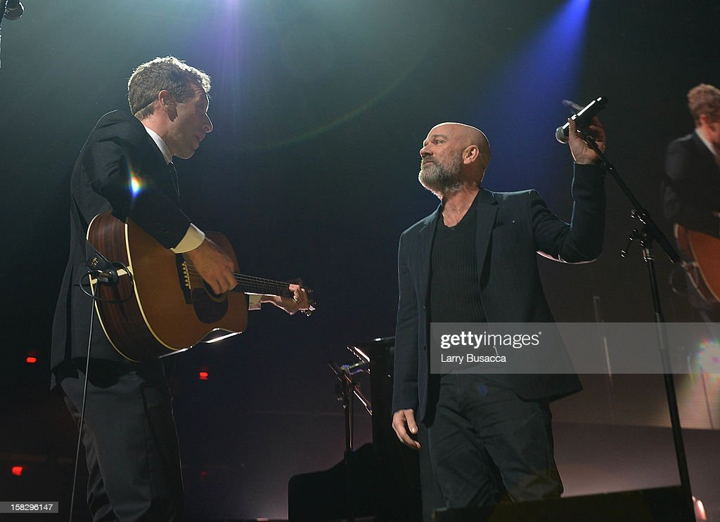 Chris Martin (L) and Michael Stipe perform at '12-12-12' a concert benefiting The Robin Hood Relief Fund to aid the victims of Hurricane Sandy presented by Clear Channel Media & Entertainment, The Madison Square Garden Company and The Weinstein Company at Madison Square Garden on December 12, 2012 in New York City.