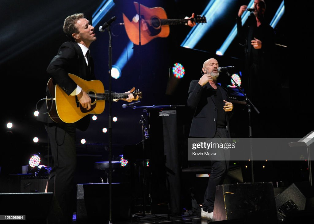 <a gi-track='captionPersonalityLinkClicked' href=/galleries/search?phrase=Chris+Martin+-+Musician&family=editorial&specificpeople=4468181 ng-click='$event.stopPropagation()'>Chris Martin</a> and <a gi-track='captionPersonalityLinkClicked' href=/galleries/search?phrase=Michael+Stipe&family=editorial&specificpeople=178318 ng-click='$event.stopPropagation()'>Michael Stipe</a> perform at '12-12-12' a concert benefiting The Robin Hood Relief Fund to aid the victims of Hurricane Sandy presented by Clear Channel Media & Entertainment, The Madison Square Garden Company and The Weinstein Company at Madison Square Garden on December 12, 2012 in New York City.