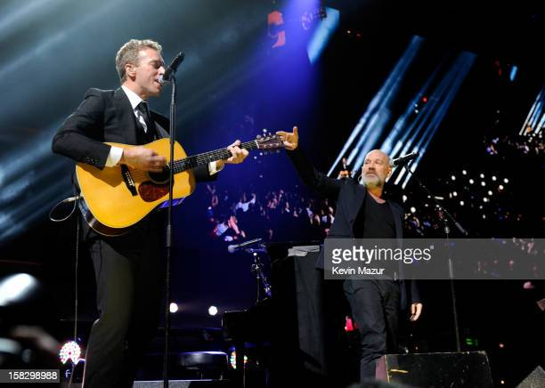 Chris Martin and Michael Stipe perform at '121212' a concert benefiting The Robin Hood Relief Fund to aid the victims of Hurricane Sandy presented by...