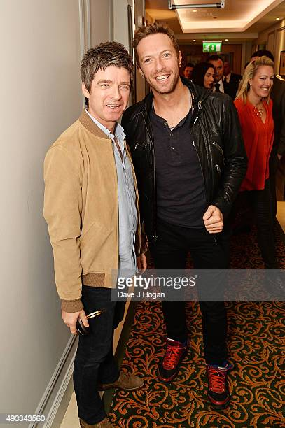 Chris Martin and Noel Gallagher attend the Q Awards at The Grosvenor House Hotel on October 19 2015 in London England