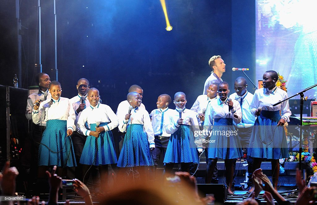 Chris Martin and the Basotho Youth Choir perform on stage at the finale of the Sentebale Concert at Kensington Palace on June 28, 2016 in London, England. Sentebale was founded by Prince Harry and Prince Seeiso of Lesotho over ten years ago. It helps the vulnerable and HIV positive children of Lesotho and Botswana.