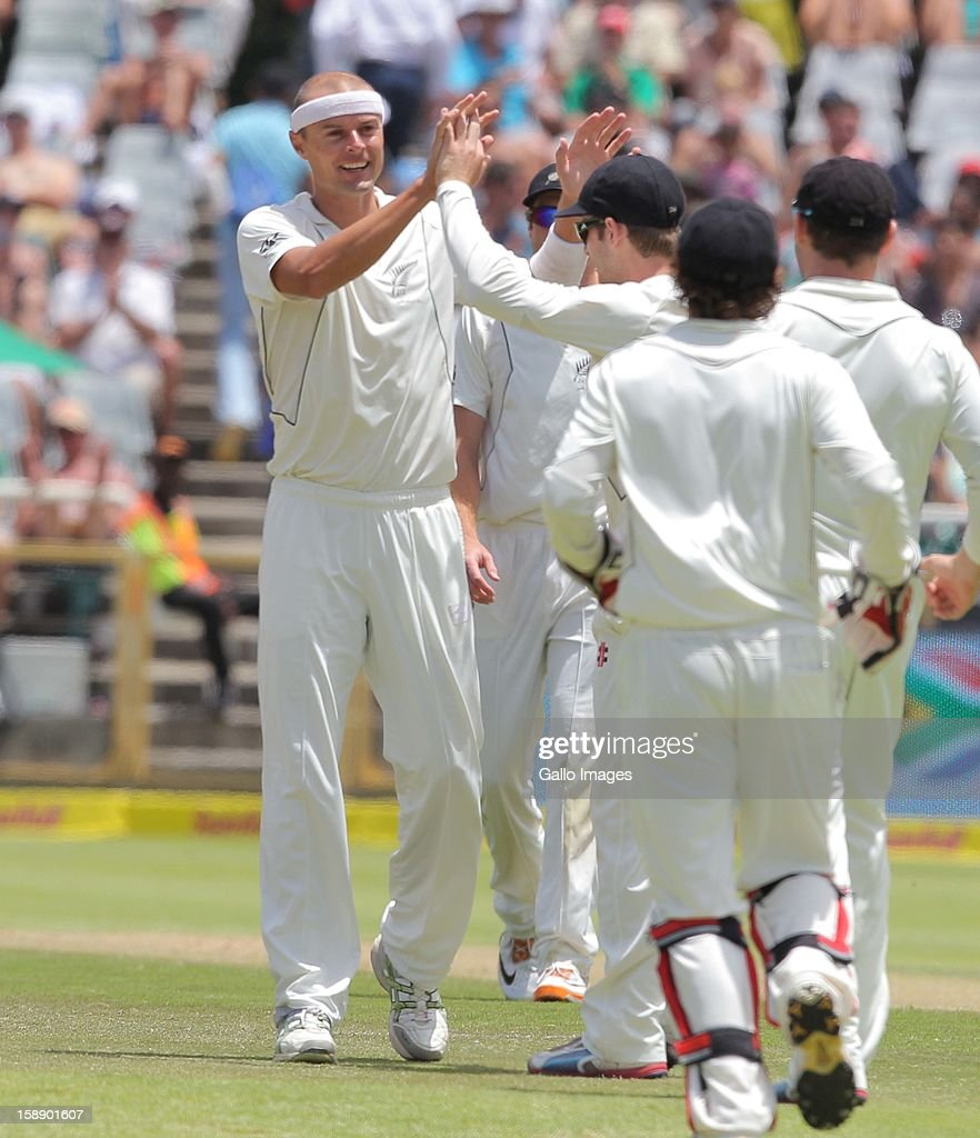 Chris Martin celebrates the wicket of AB de Villiers from the Proteas during day 2 of the 1st Test between South Africa and New Zealand at Sahara Park Newlands on January 03, 2013 in Cape Town, South Africa.
