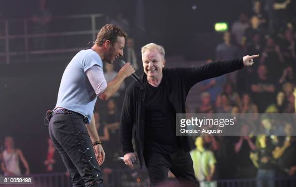 Chris Martin from Coldplay and Herbert Groenemeyer perform during the Global Citizen Festival at the Barclaycard Arena on July 6 2017 in Hamburg...
