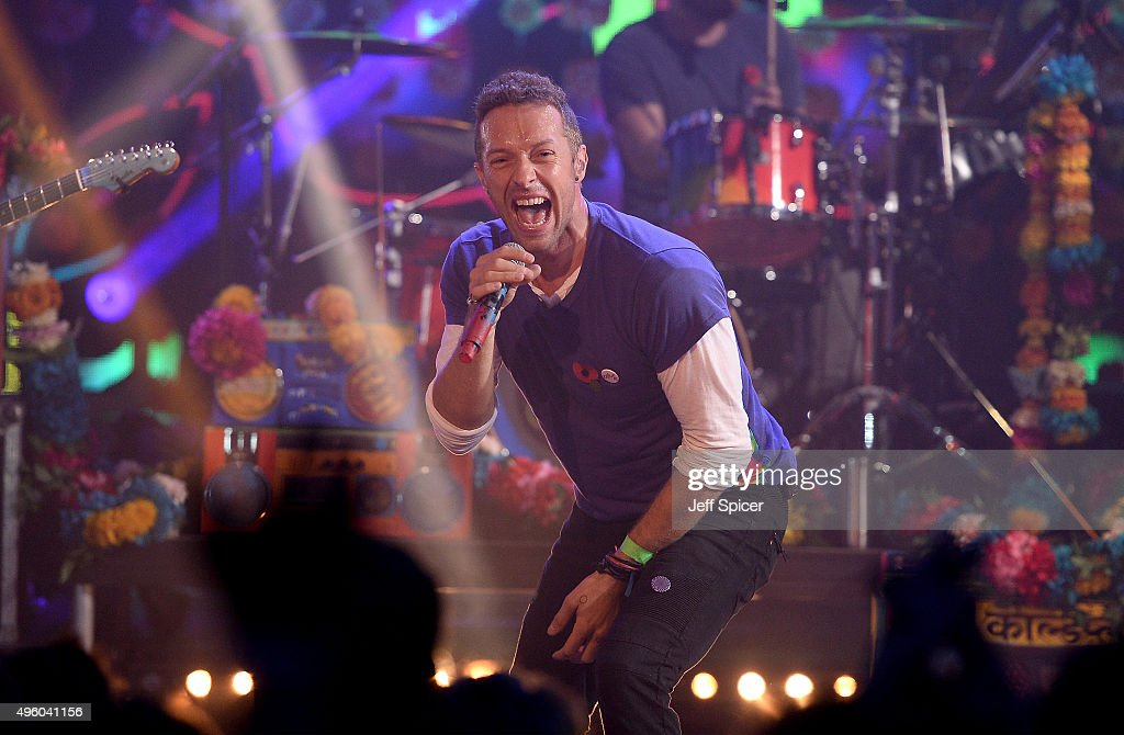 Chris Martin from Coldplay performs during a live broadcast of 'TFI Friday' at the Cochrane Theatre on November 6 2015 in London England