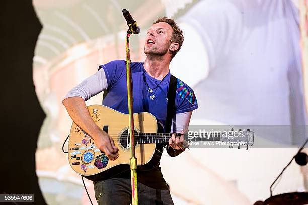 Chris Martin from Coldplay performs on stage at Powderham Castle on May 29 2016 in Exeter England