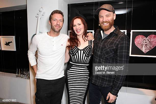 Chris Martin Mila Furstova and Jonny Buckland attend a private view of 'Coldplay Ghost Stories' an exhibition of artwork by Mila Furstova from the...