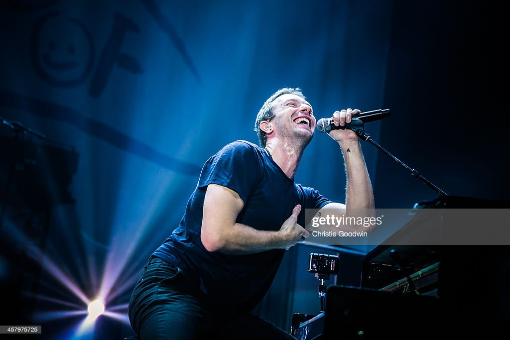 <a gi-track='captionPersonalityLinkClicked' href=/galleries/search?phrase=Chris+Martin+-+Musician&family=editorial&specificpeople=4468181 ng-click='$event.stopPropagation()'>Chris Martin</a> of Coldplay performs at the 'Under 1 Roof' concert in aid of Kids Company at Hammersmith Apollo on December 19, 2013 in London, England.