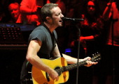 Chris Martin of Coldplay performs live on stage at the Royal Albert Hall on July 1 2014 in London England