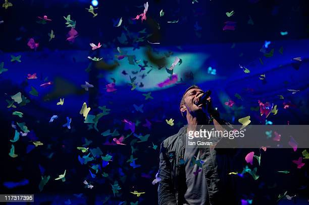 Chris Martin of Coldplay performs live on the pyramid stage during the Glastonbury Festival at Worthy Farm Pilton on June 25 2011 in Glastonbury...