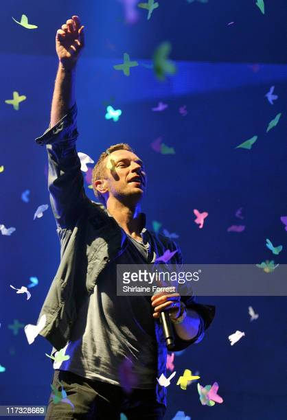 Chris Martin of Coldplay performs on day three of Glastonbury Festival at Worthy Farm on June 25 2011 in Glastonbury England