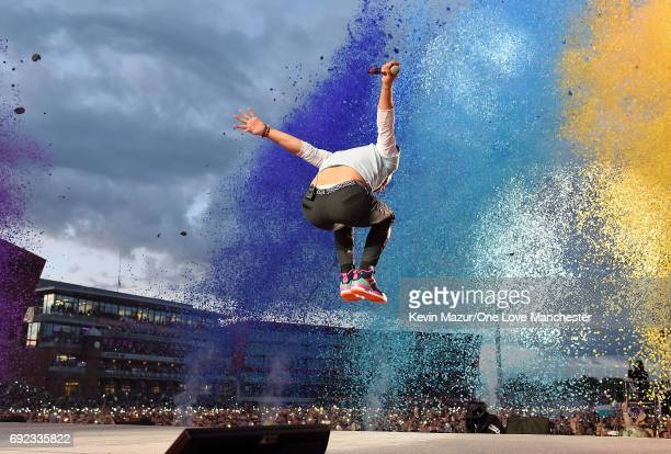 Chris Martin of Coldplay performs on stage during the One Love Manchester Benefit Concert at Old Trafford Cricket Ground on June 4 2017 in Manchester...