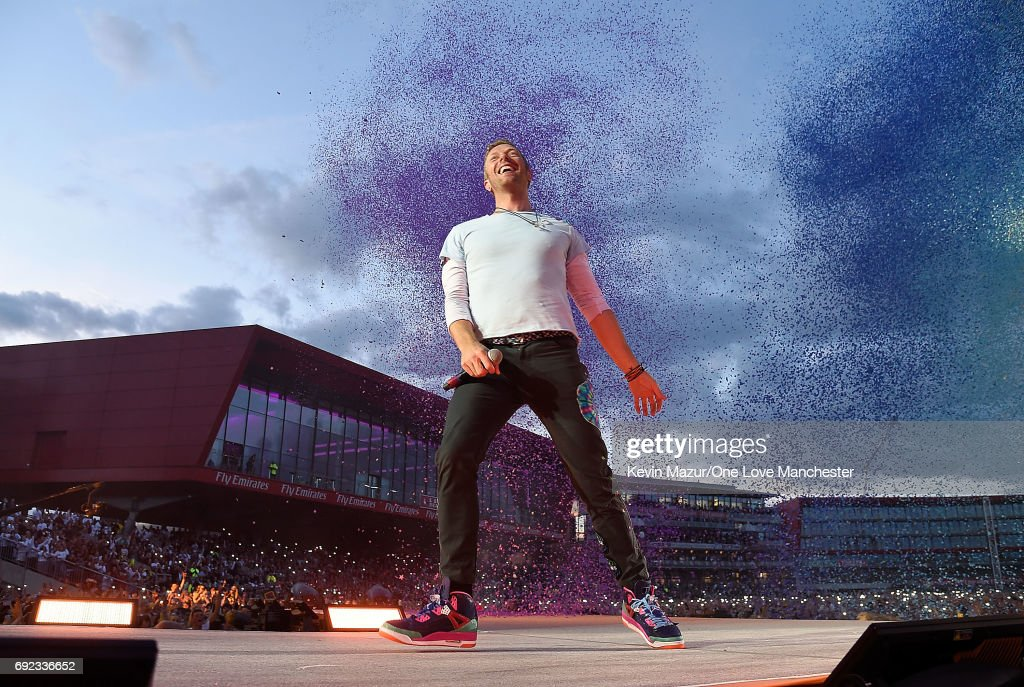 Chris Martin of Coldplay performs on stage during the One Love Manchester Benefit Concert at Old Trafford Cricket Ground on June 4, 2017 in Manchester, England.