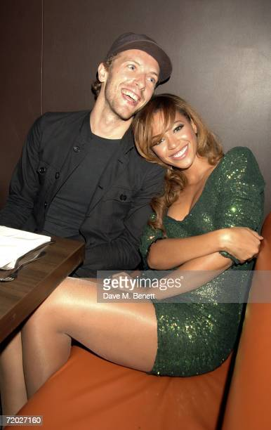 Chris Martin of Coldplay with singer Beyonce Knowles attend the after party following the concert by JayZ at The Royal Albert Hall at Movida on...