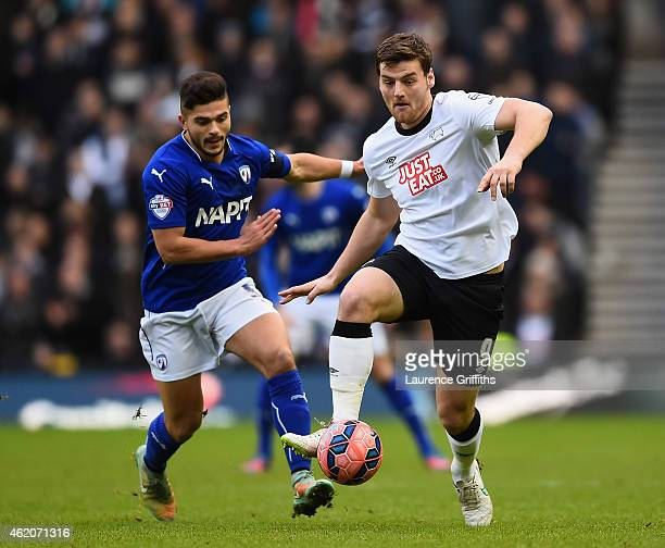 Chris Martin of Derby County battles with Sam Morsy of Chesterfield during the FA Cup Fourth Round match between Derby County and Chesterfield at...