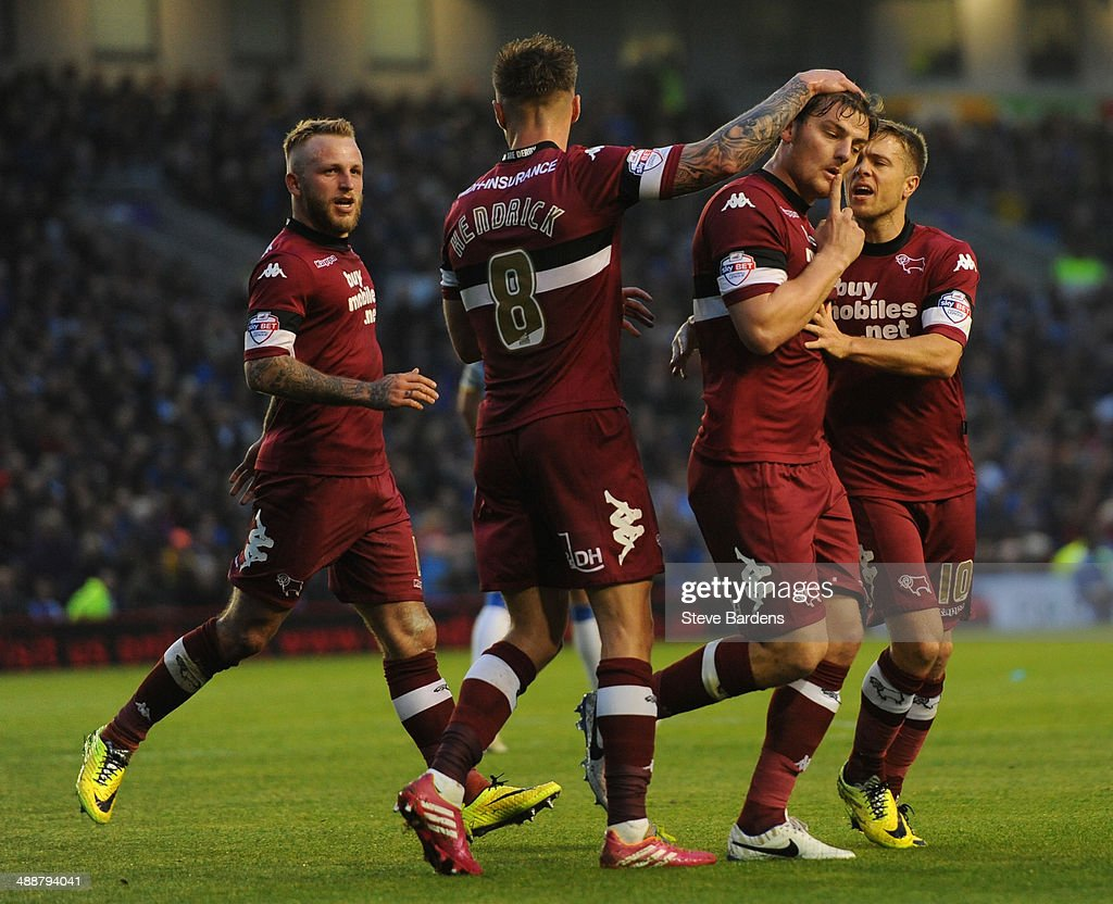Chris Martin of Derby County (2nd R) celebrates scoring from the penalty spot with his team mates during the Sky Bet Championship Play Off semi final first leg match between Brighton & Hove Albion and Derby County at Amex Stadium on May 8, 2014 in Brighton, England.