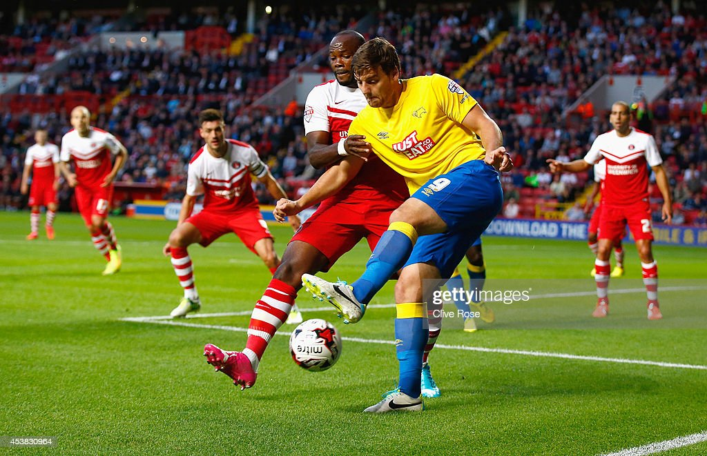 Chris Martin of Derby County is challenged by Andre Bikey-Amougou of Charlton during the Sky Bet Championship match between Charlton Athletic and Derby County at The Valley on August 19, 2014 in London, England.