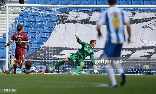 Chris Martin of Derby slots the ball past Tomasz Kuszczak of Brighton for the winning goal during the Sky Bet Championship match between Brighton...