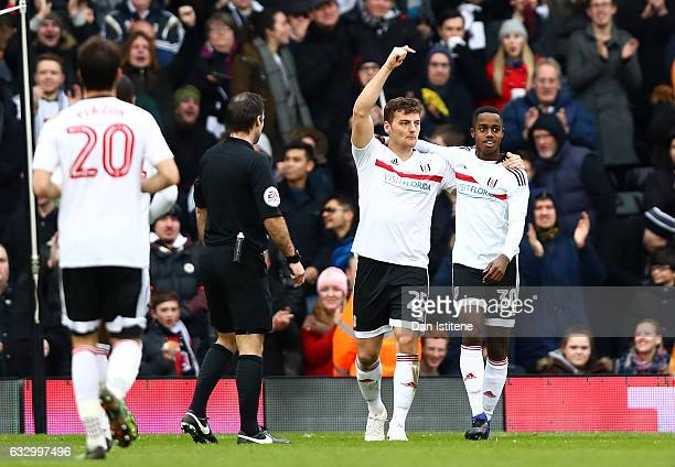 Chris Martin of Fulham FC celebrates scoring his sides second goal with Ryan Sessegnon of Fulham FC during The Emirates FA Cup Fourth Round match...