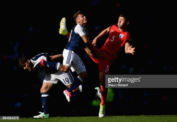 Chris Martin of Scotland and Ryan Fraser of Scotland battle for possession with Gary Cahill of England during the FIFA 2018 World Cup Qualifier...