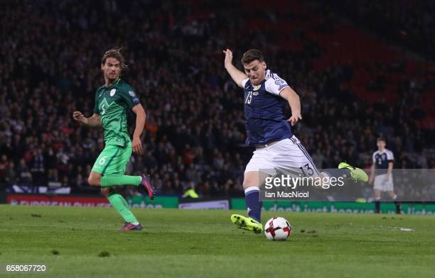 Chris Martin of Scotland scores during the FIFA 2018 World Cup Qualifier between Scotland and Slovenia at Hampden Park on March 26 2017 in Glasgow...