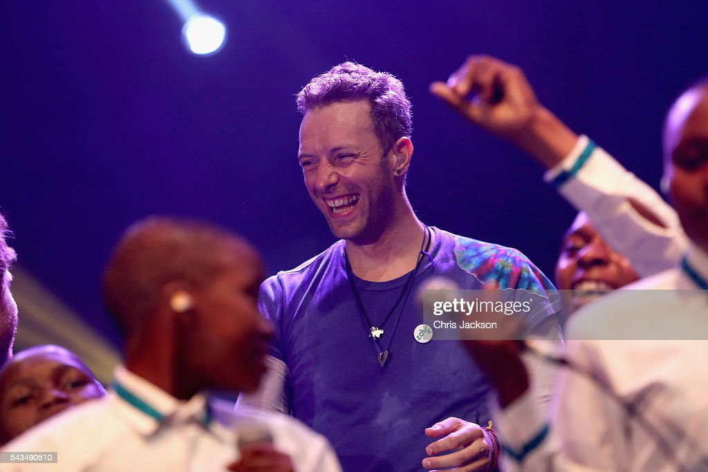Chris Martin on stage with the Basotho Youth Choir at the finale of the Sentebale Concert at Kensington Palace on June 28, 2016 in London, England. Sentebale was founded by Prince Harry and Prince Seeiso of Lesotho over ten years ago. It helps the vulnerable and HIV positive children of Lesotho and Botswana.