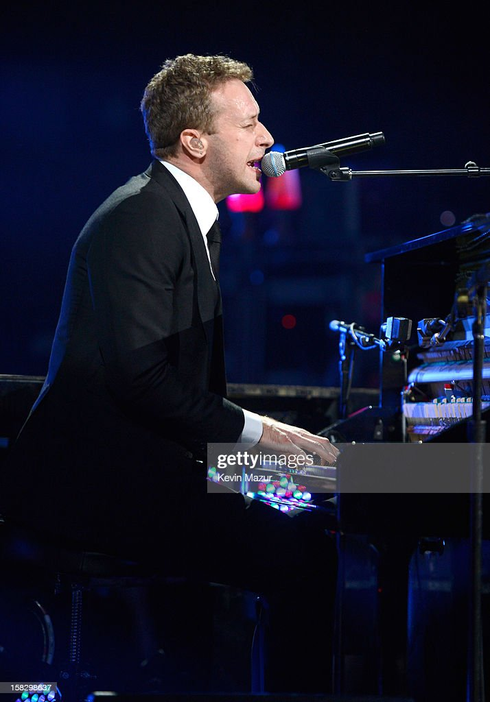 Chris Martin performs at '12-12-12' a concert benefiting The Robin Hood Relief Fund to aid the victims of Hurricane Sandy presented by Clear Channel Media & Entertainment, The Madison Square Garden Company and The Weinstein Company at Madison Square Garden on December 12, 2012 in New York City.