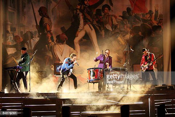 Chris Martin Will Champion Guy Berryman and Jonny Buckland of Coldplay rehearse for the Brit Awards 2009 held at Earls Court on February 18 2009 in...