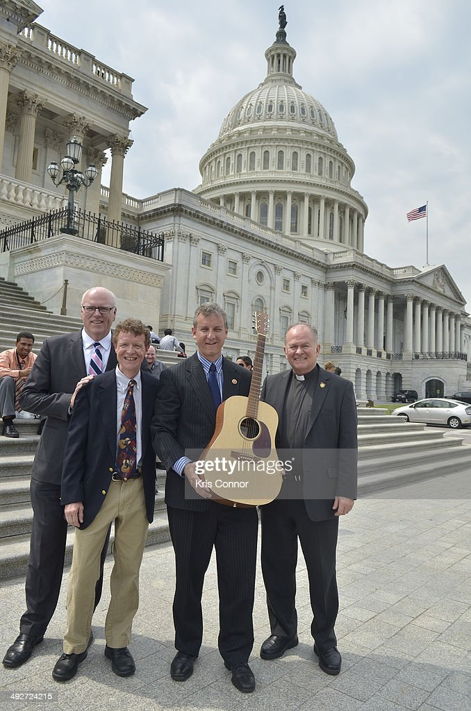Chris Martin with other NAMM members meet with Rep. Matt Cartwright(D-PA), Father Patrick J. Conroy and Rep. Joseph Crowley(D-NY) on the steps of the capitol during NAMM D.C. Fly-in at the US Capitol on May 21, 2014 in Washington, DC.