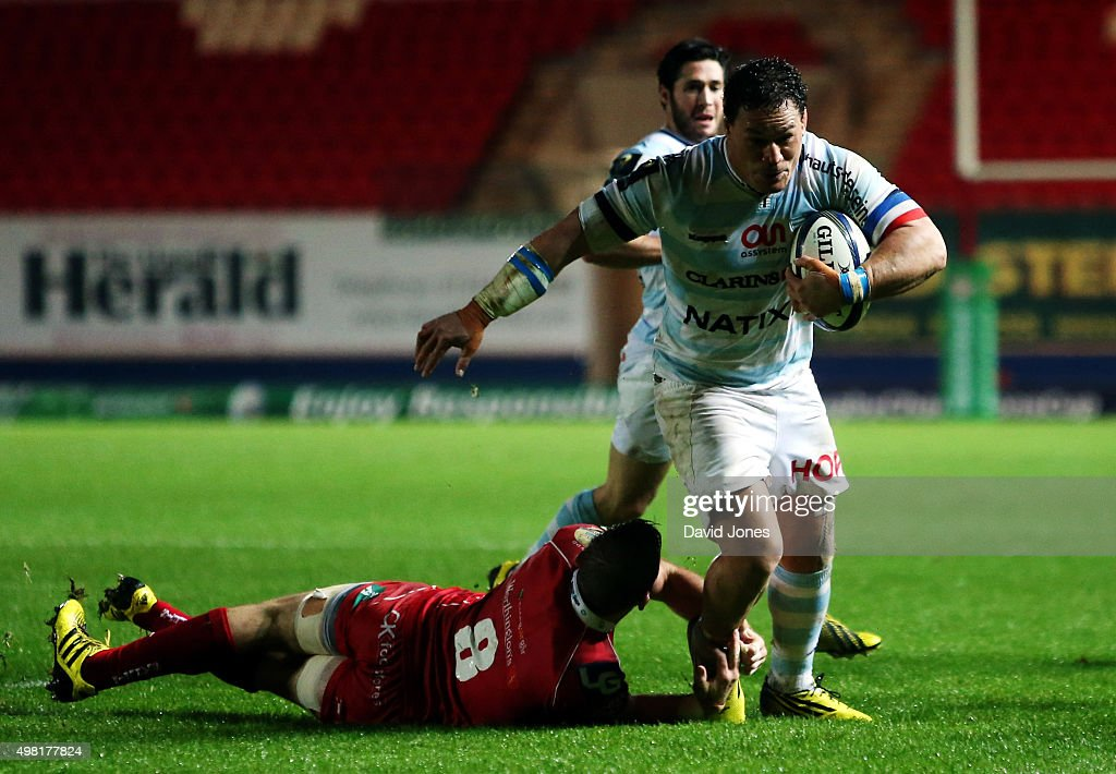 <a gi-track='captionPersonalityLinkClicked' href=/galleries/search?phrase=Chris+Masoe&family=editorial&specificpeople=540337 ng-click='$event.stopPropagation()'>Chris Masoe</a> of Racing 92 evades <a gi-track='captionPersonalityLinkClicked' href=/galleries/search?phrase=John+Barclay+-+Rugby+Player&family=editorial&specificpeople=574914 ng-click='$event.stopPropagation()'>John Barclay</a> of Scarlets to score a try during the European Rugby Champions Cup match between Scarlets and Racing 92 at the Parc y Scarlets on November 21, 2015 in Llanelli, Wales.