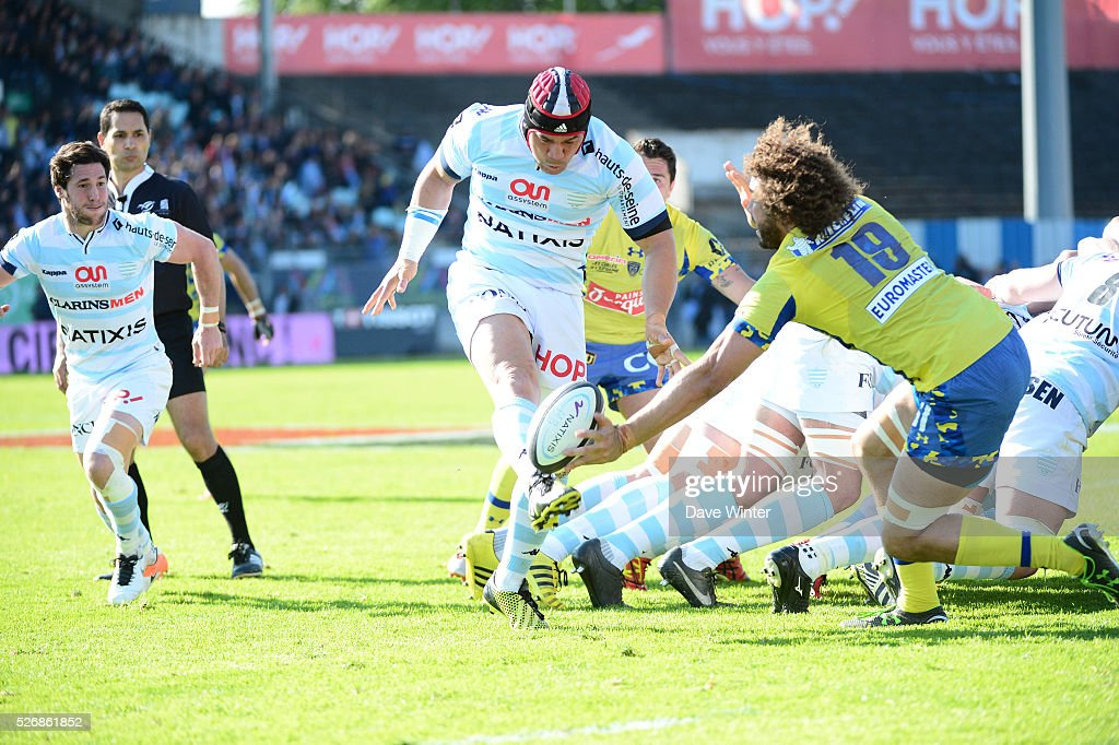 Chris Masoe of Racing 92 has his kick into touch charged down by Camille Gerondeau of Clermont during the French Top 14 rugby union match between Racing 92 v Clermont at Stade Yves Du Manoir on May 1, 2016 in Colombes, France.