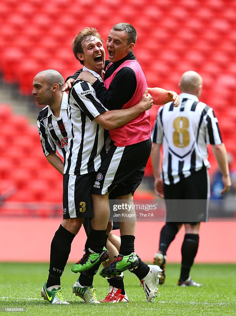 Chris Mason of Spennymoor Town celebrates the win with team mates during the FA Carlsberg Vase Final match between Spennymoor Town FC and Tunbridge Wells FC at Wembley Stadium on May 4, 2013 in London, England.