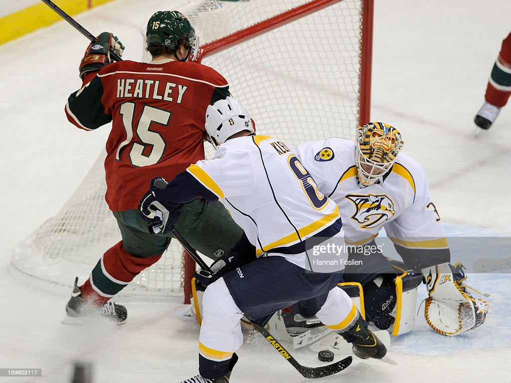 Chris Mason #30 of the Nashville Predators blocks a shot by Dany Heatley #15 of the Minnesota Wild as Kevin Klein #8 of the Nashville Predators helps to defend the net during the second period during the game on January 22, 2013 at Xcel Energy Center in St Paul, Minnesota. The Predators defeated the Wild 3-1.