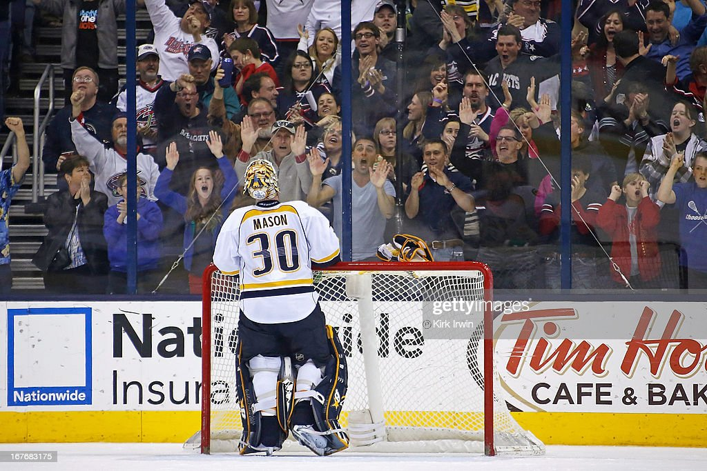 Chris Mason #30 of the Nashville Predators is heckled by Columbus Blue Jackets fans after giving up the game winning goal during the third period on April 27, 2013 at Nationwide Arena in Columbus, Ohio. Columbus defeated Nashville 3-1.