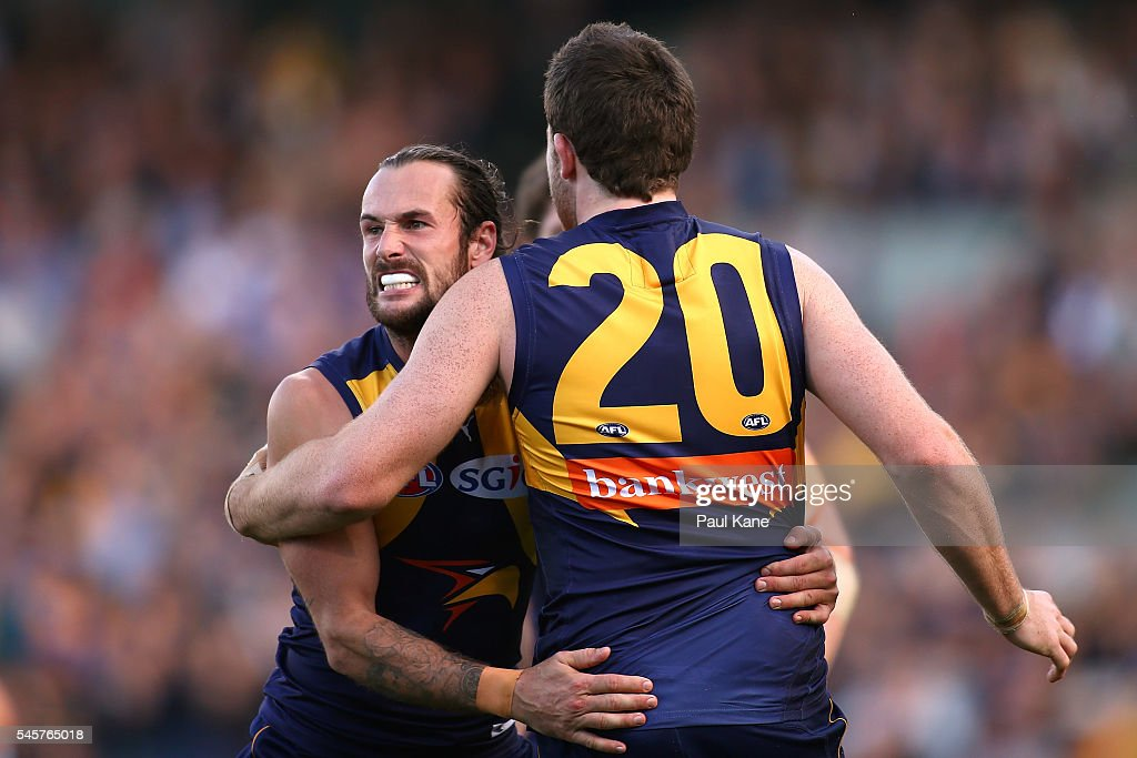 Chris Masten of the Eagles celebrates a goal with Jeremy McGovern during the round 16 AFL match between the West Coast Eagles and the North Melbourne Kangaroos at Domain Stadium on July 10, 2016 in Perth, Australia.