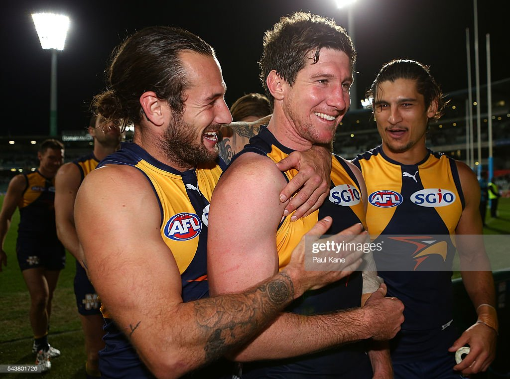 Chris Masten of the Eagles embraces Patrick McGinnity of the Eagles as the players walk from the field after winning the round 15 AFL match between the West Coast Eagles and the Essendon Bombers at Domain Stadium on June 30, 2016 in Perth, Australia.