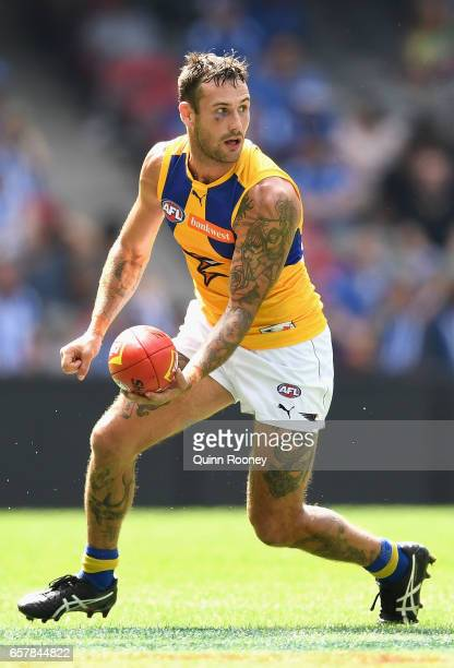 Chris Masten of the Eagles handballs during the round one AFL match between the North Melbourne Kangaroos and the West Coast Eagles at Etihad Stadium...