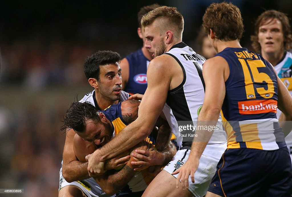 Chris Masten of the Eagles is tackled by Dom Cassisi and Jackson Trengove of the Power during the round five AFL match between the West Coast Eagles and the Port Power at Patersons Stadium on April 19, 2014 in Perth, Australia.
