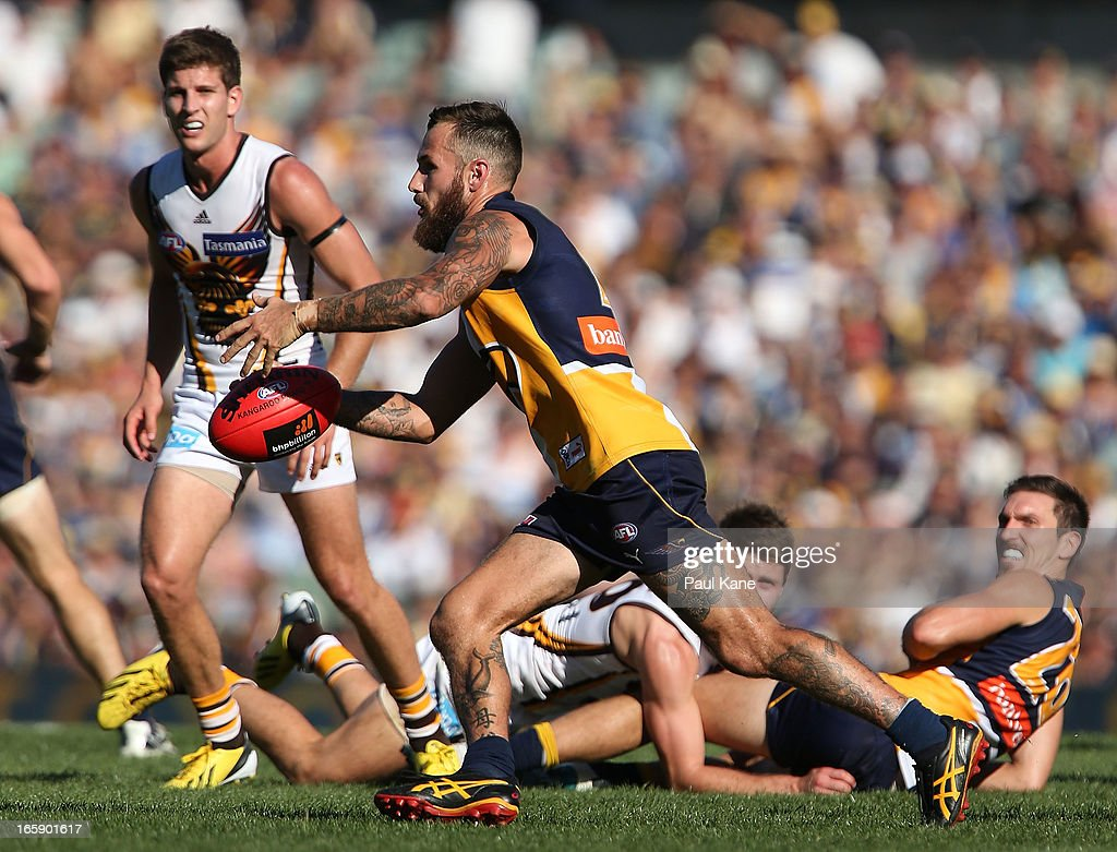 Chris Masten of the Eagles looks to clear the ball during the round two AFL match between the West Coast Eagles and the Hawthorn Hawks at Patersons Stadium on April 7, 2013 in Perth, Australia.