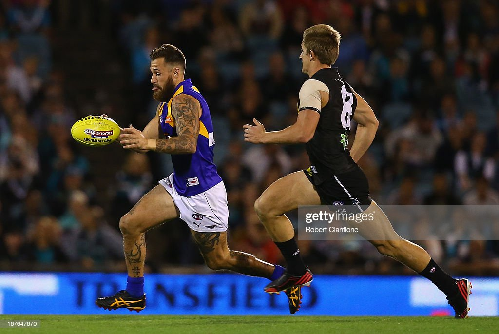 Chris Masten of the Eagles runs with the ball during the round five AFL match between Port Adelaide Power and the West Coast Eagles at AAMI Stadium on April 27, 2013 in Adelaide, Australia.